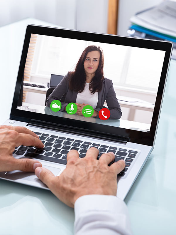Video conferencing software on a laptop